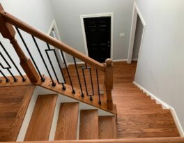 Small Changes Make A Big Difference: Newel Posts, Handrails, and Iron Balusters